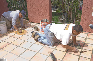 Roofers Working on Tiled Patio