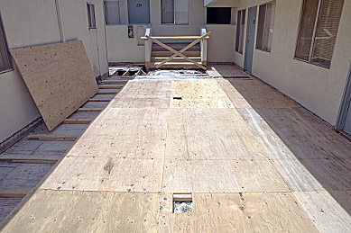 Apartment walkway plywood