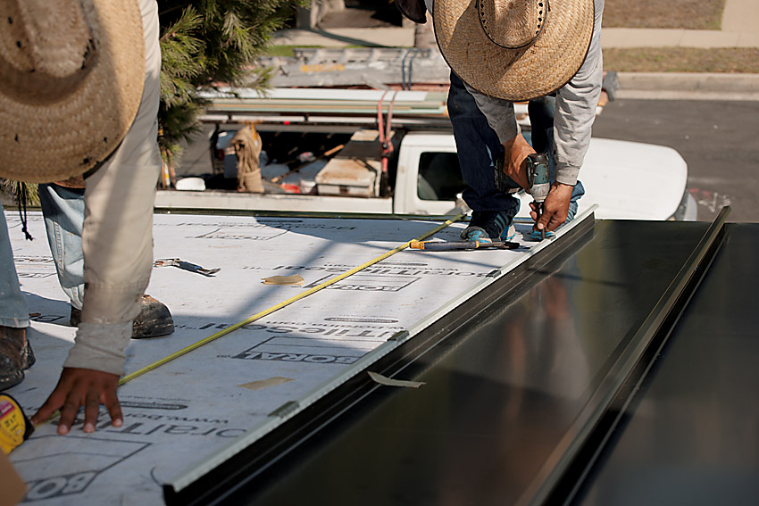 Measuring and installing metal roof panels