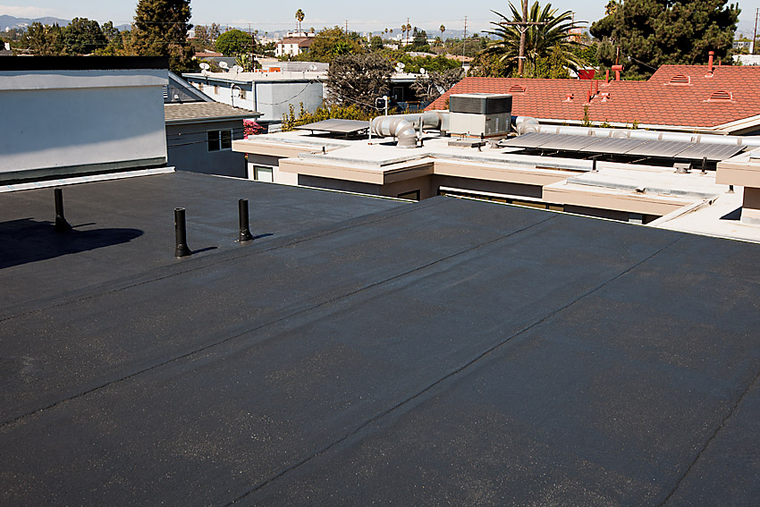 Flat roof with black coating