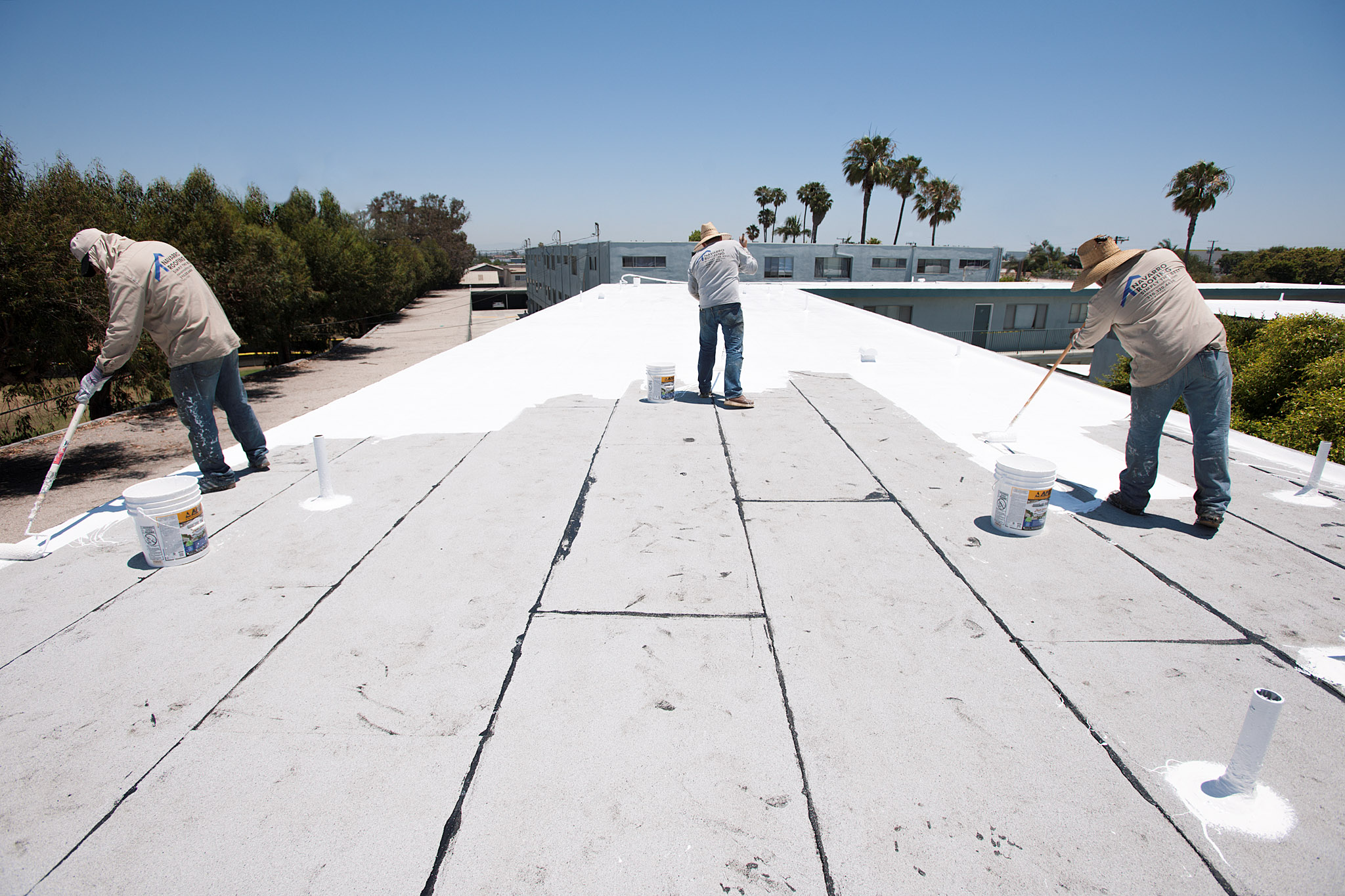 Cool Roof White Silicon Coating On Apartment Building Torrance