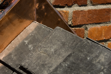Detail of Slate with Copper Trim and Brick Chimney