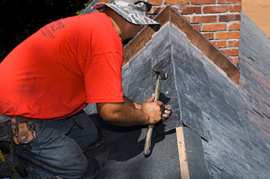 Roofer Working on Slate Roof